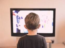 kid looking at tv screen