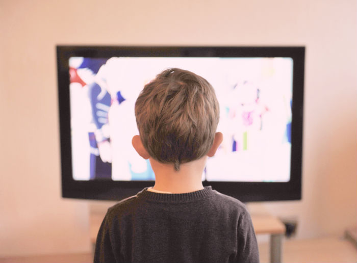 kid looking at tv screen