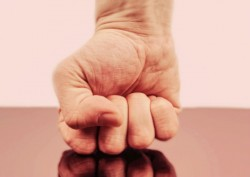 clenched fist set on glass surface