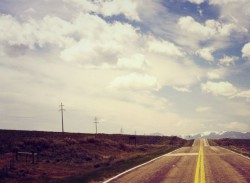 straight paved road to the horizon