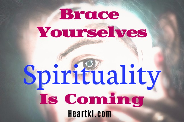 spirituality is coming written over a background of person looking at screen with light effects