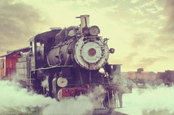 steam locomotive with cloudy sky backdound