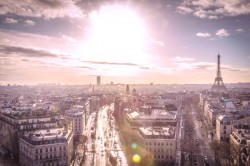 photography of Paris with Sun in the background