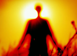 blurred silhouette of a person against the sun